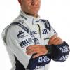 """8899 Бразильский гонщик, который конкурировал в Формуле Один между 1993 и 2011, Рубенс Гонсэйльвс """"Rubinho"""" Барикелло."""