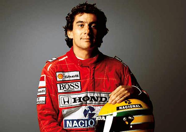 Айртон Сенна да Сильва, бразильский гонщик, который выиграл три чемпионата мира Формулы 1.